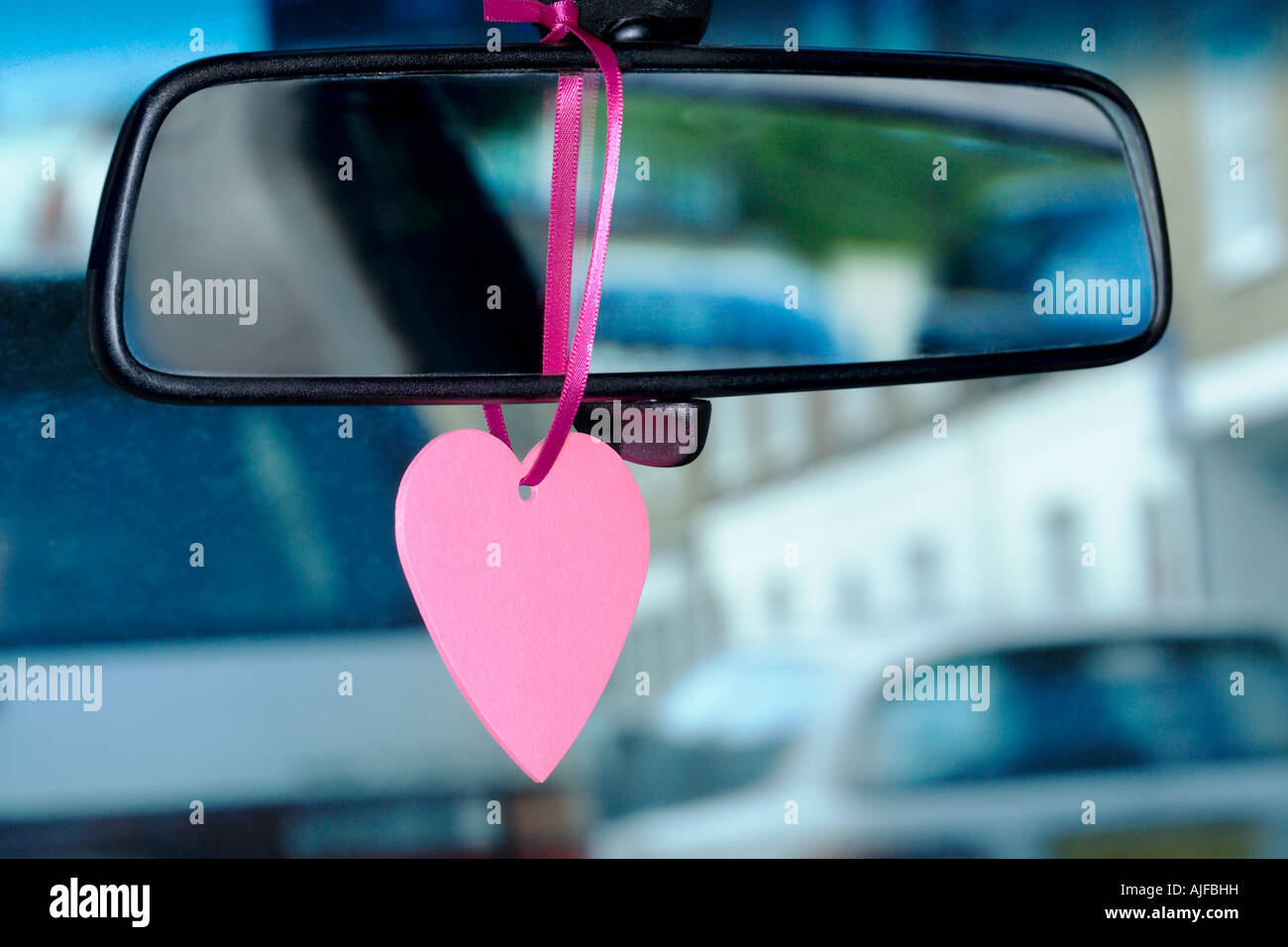 A trinket hanging on a rearview mirror Stock Foto