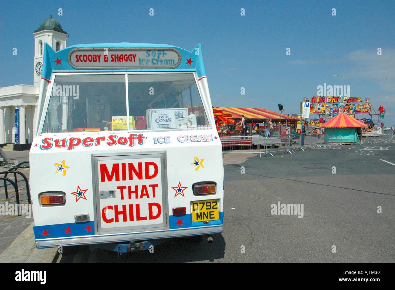 ice-cream-van-with-funfair-in-the-backgr