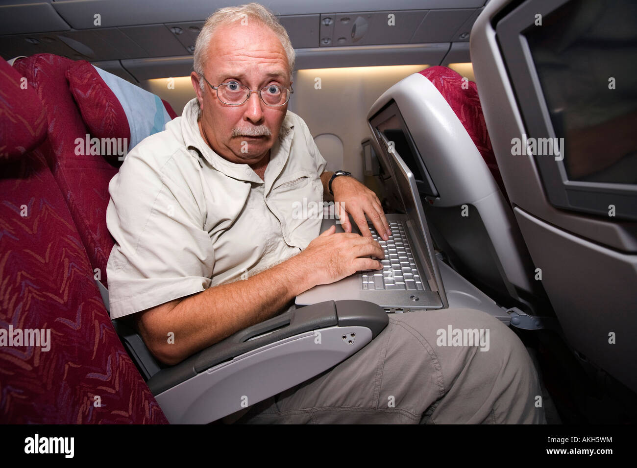 Travel Middle Aged Airline Passenger Squashed Into Economy