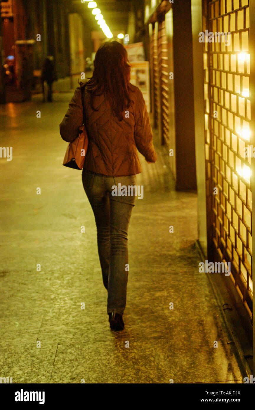 Italy, Milan, Lady walking down the street Stock Foto