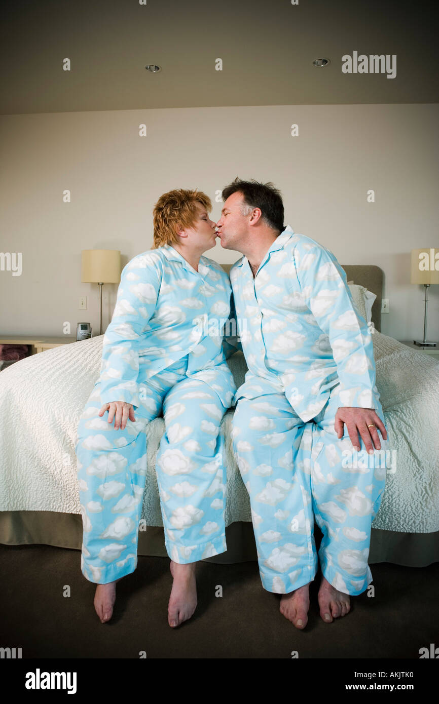Couple in matching pajamas kissing Stock Foto