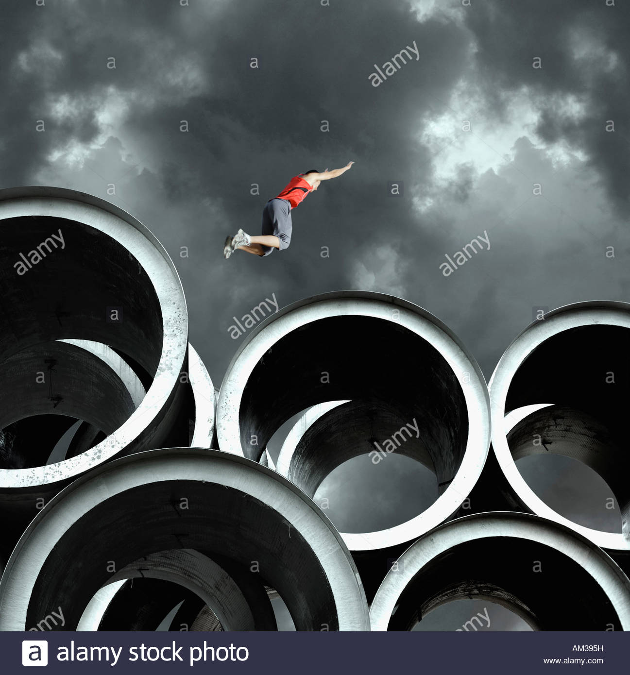 Long jumper on large cylinders Stock Foto