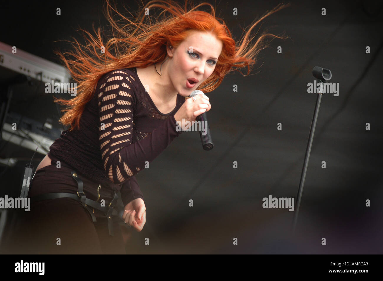 fiery red haired mezzo soprano Simone Simons singer with ...