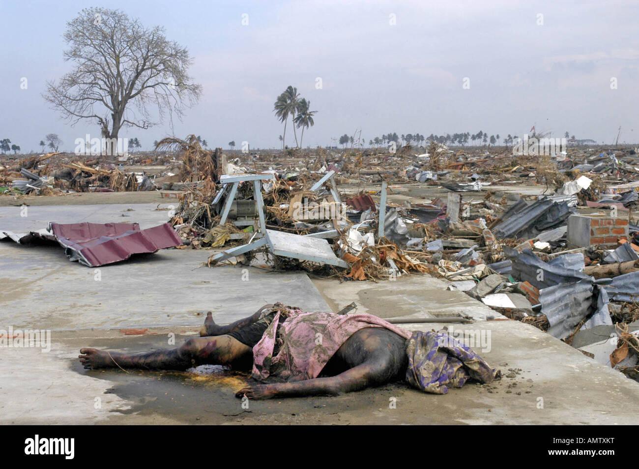 A victim of the Dec 26th Tsunami holds in Uleh leh Banda ...
