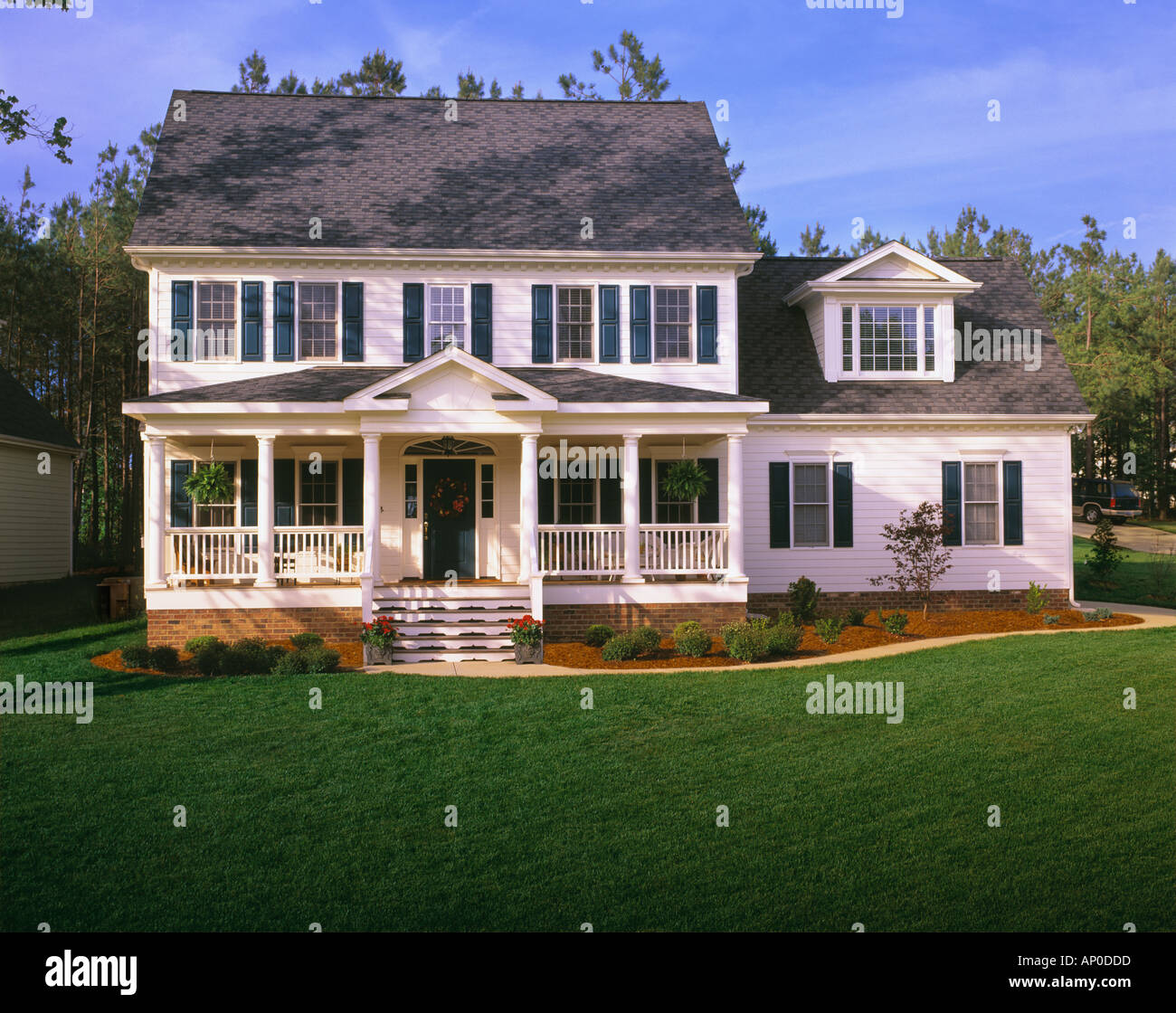 Front Porch Of Yellow House Stock Photo: Large White Two Story House With Blue Shutters A Front