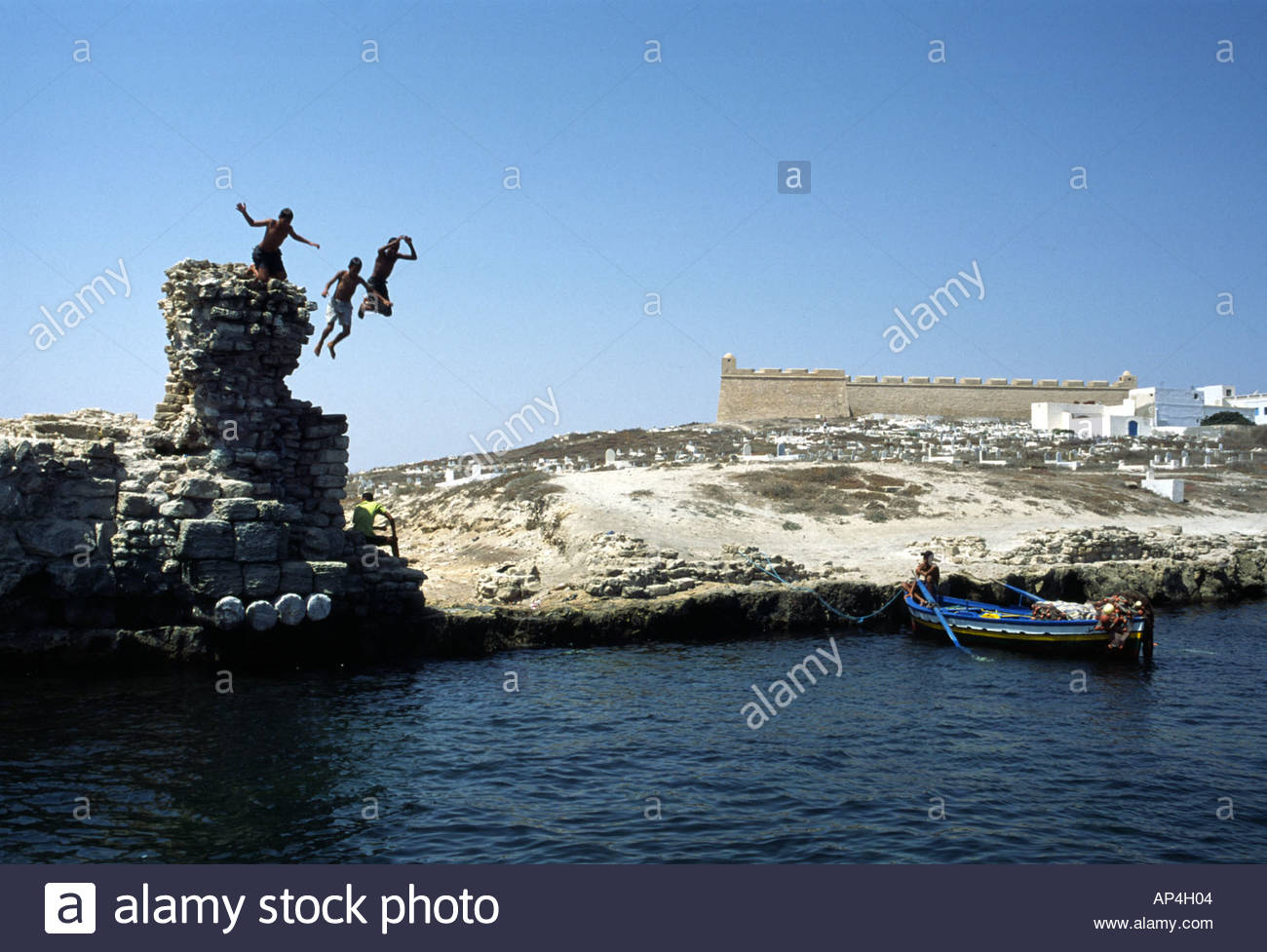mahdia-tunisia-kids-playing-at-the-old-fatimid-port-behind-the-borj-AP4H04.jpg