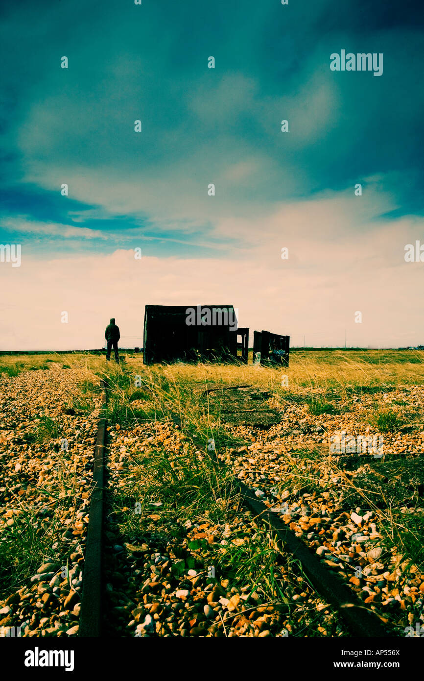 Man standing next to shack on a beach Stock Foto