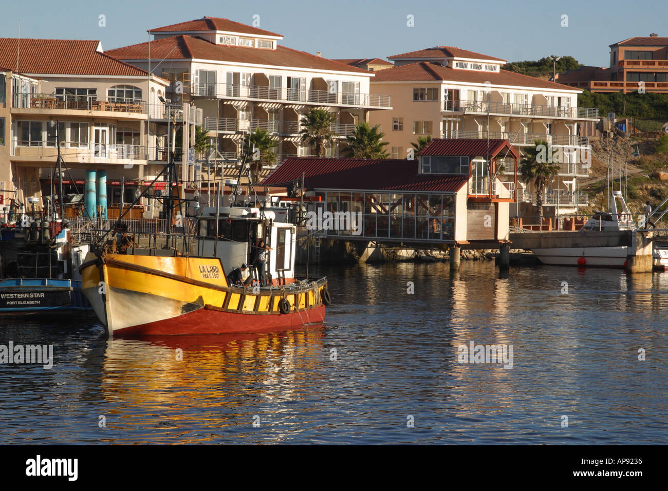 Harbour St Francis Bay with fishing boat Stock Photo