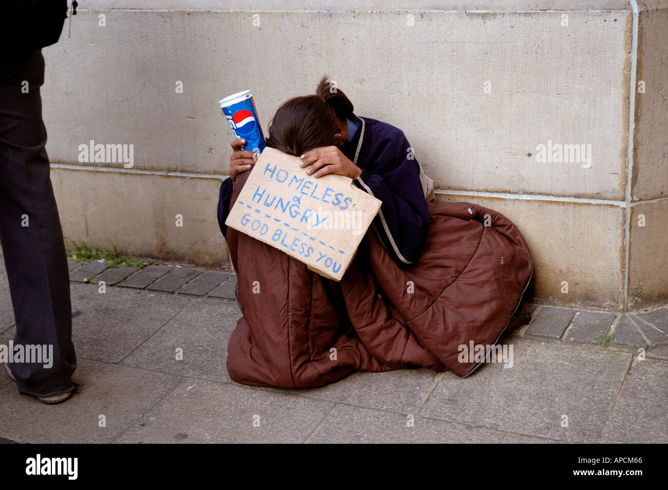 Young person homeless hungry and begging in London. Stock Photo