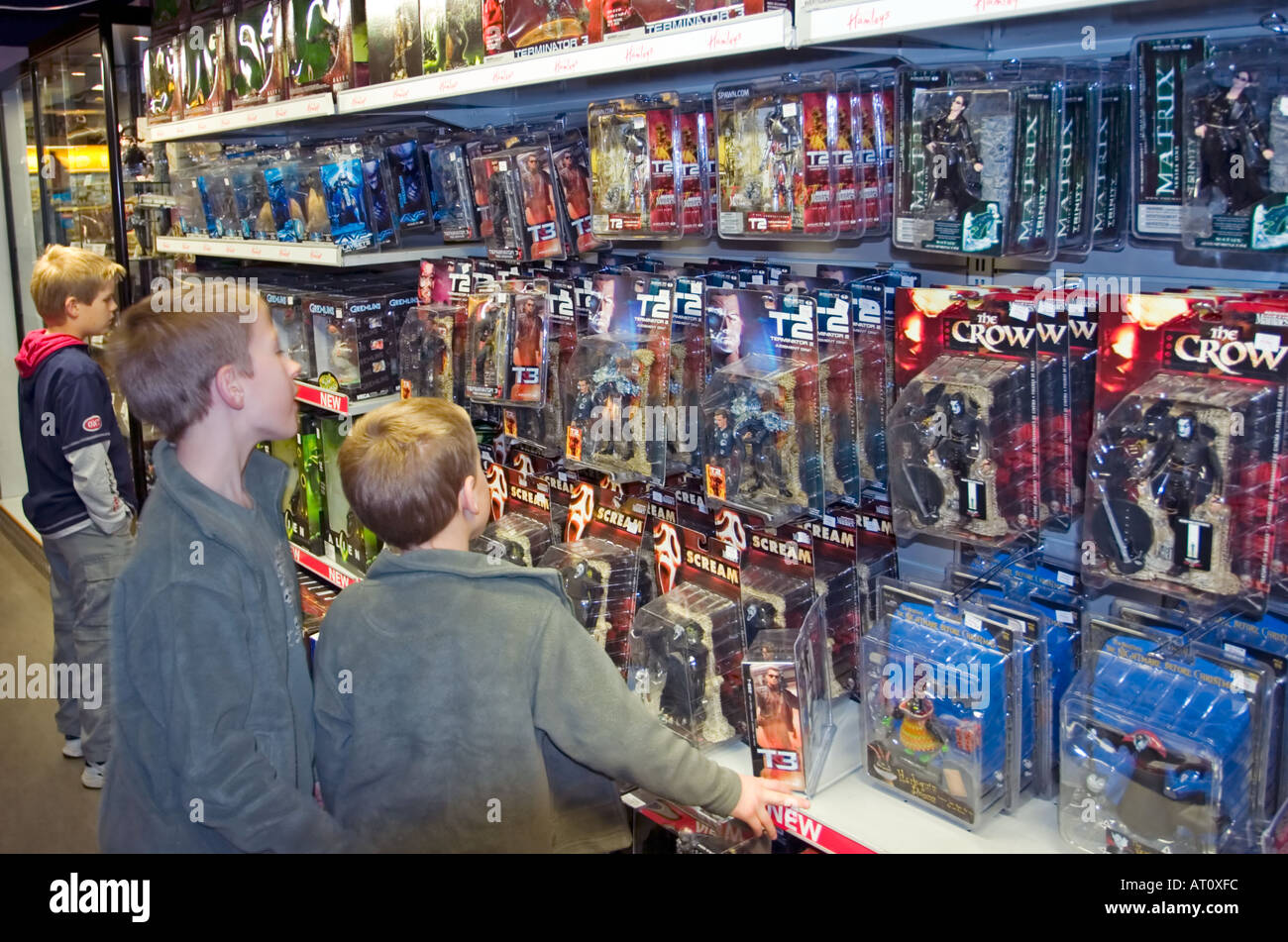 Toys For Boys Store : Young boys shop for action figure toys in hamley s store