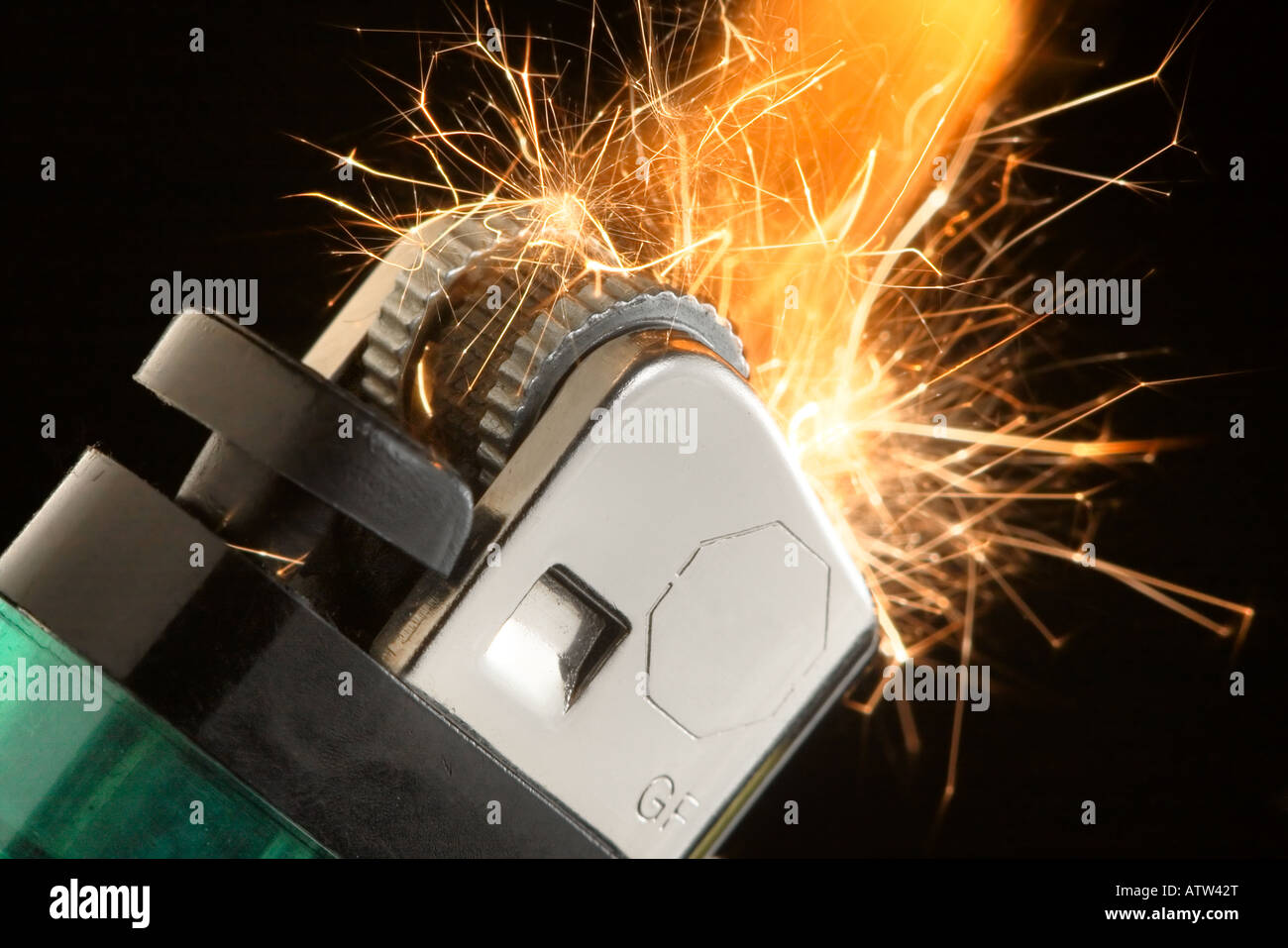 A closeup of a pocket lighter parking and flaming Stock Photo