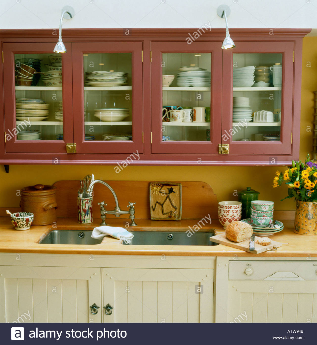 Kitchen Units And Sink In Country Style Kitchen With Glass