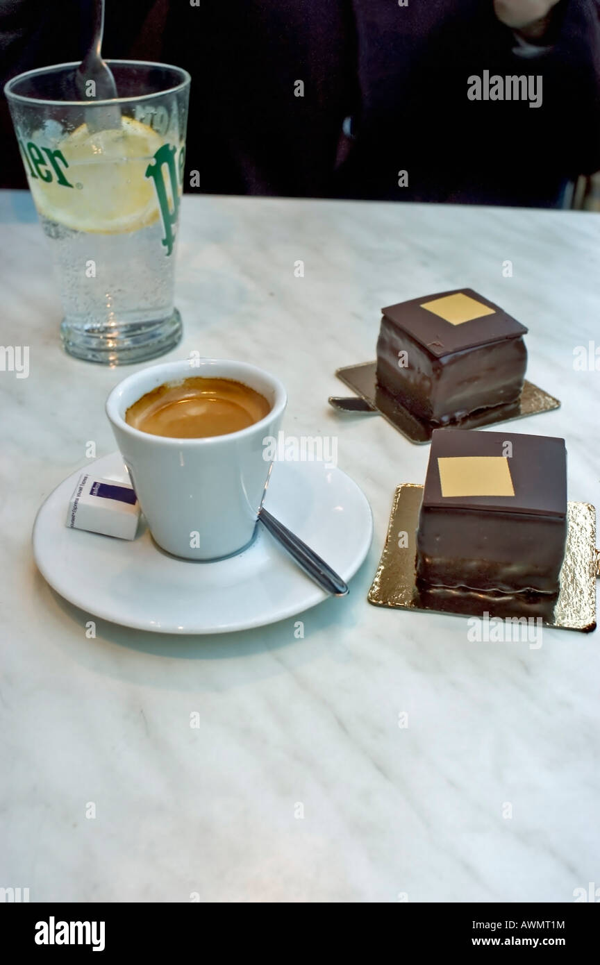 """Paris France, French Luxury """"Chocolate Cakes"""" and Espresso Coffee, Store, """"Pierre Hermé"""" Marble Table, detail, Pastries Stock Photo"""