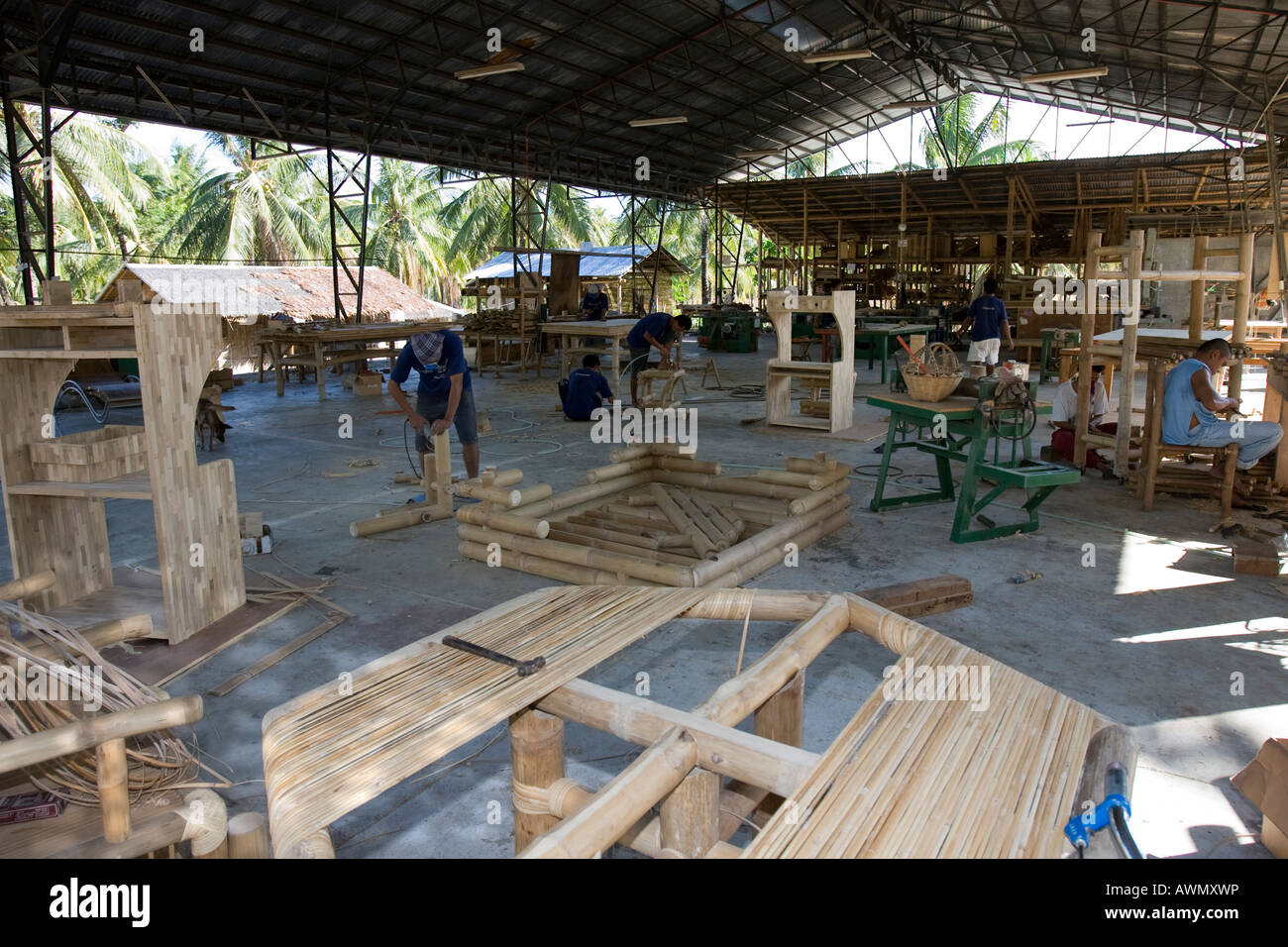 Bamboo being processed at a furniture factory in negros for Furniture factory