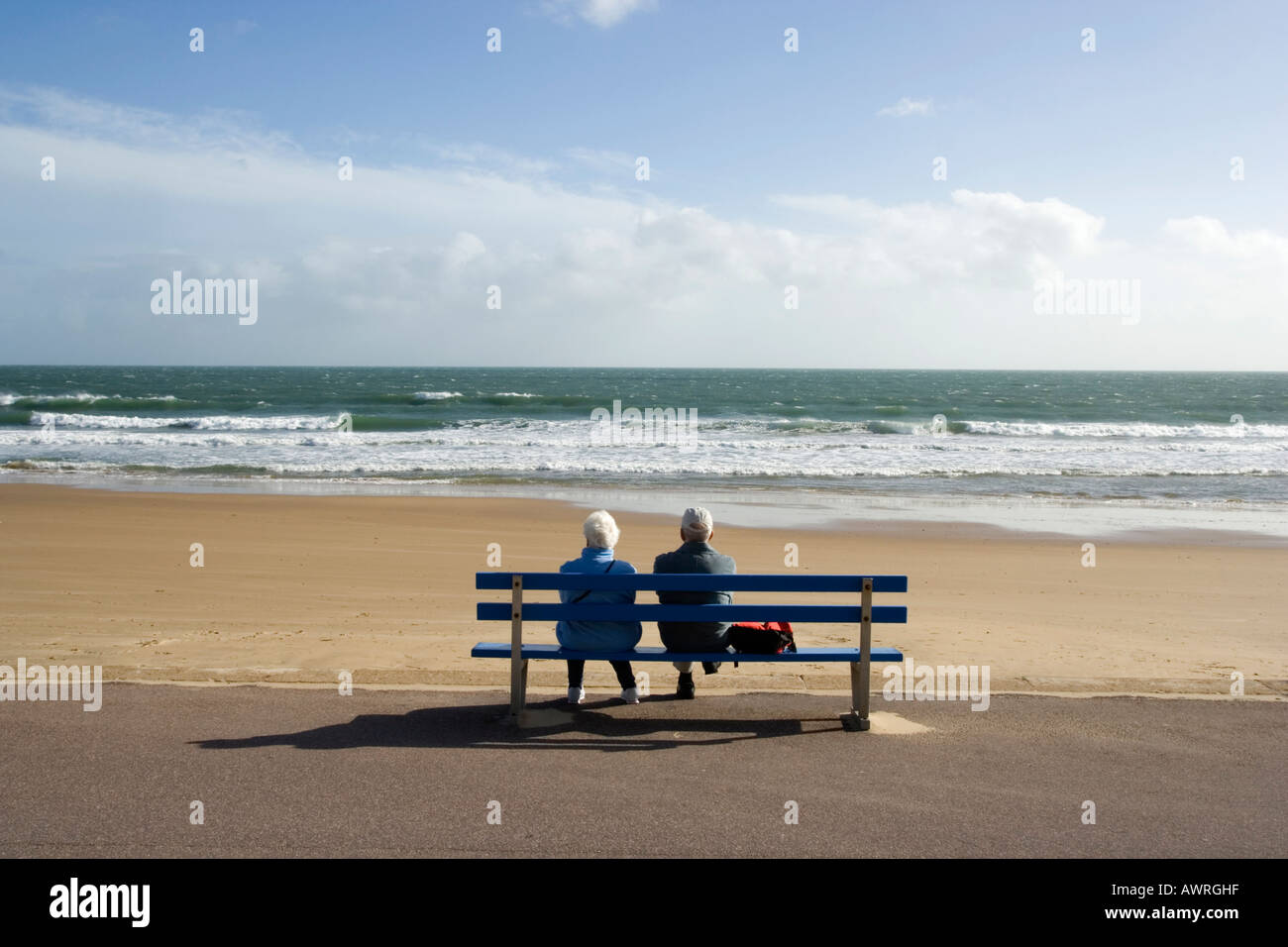 An elderly couple looking out to sea, Bournemouth, Dorset,  UK Stock Photo
