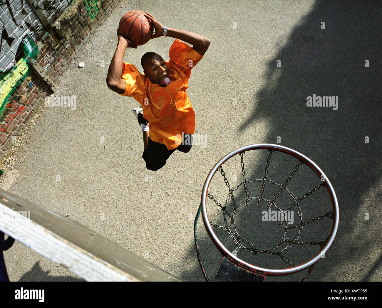 Man going up for a basketball dunk, shot from above Stock Photo