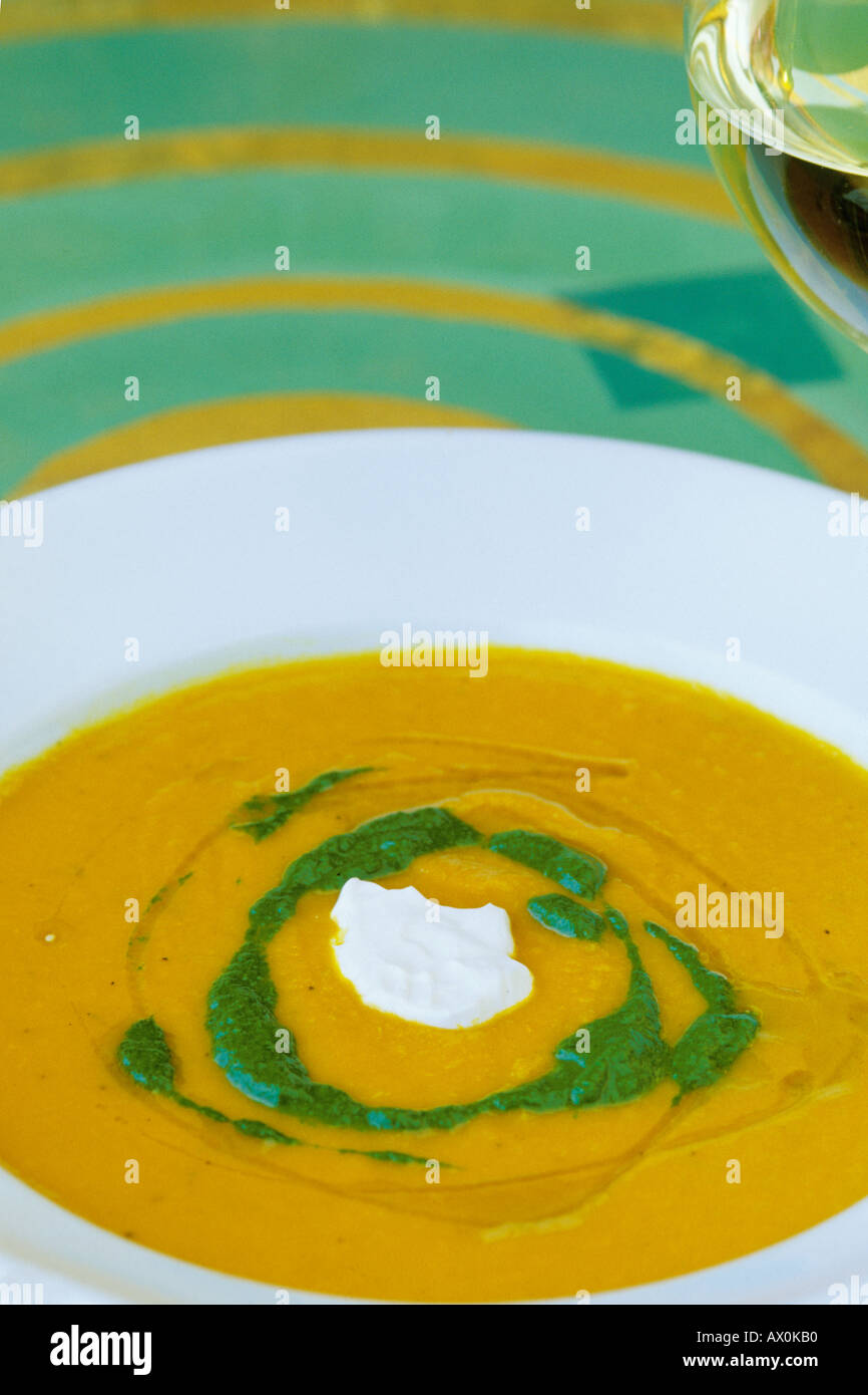 Food, Carrot ginger rosemary soup with sour cream and spinach coulis Stock Photo