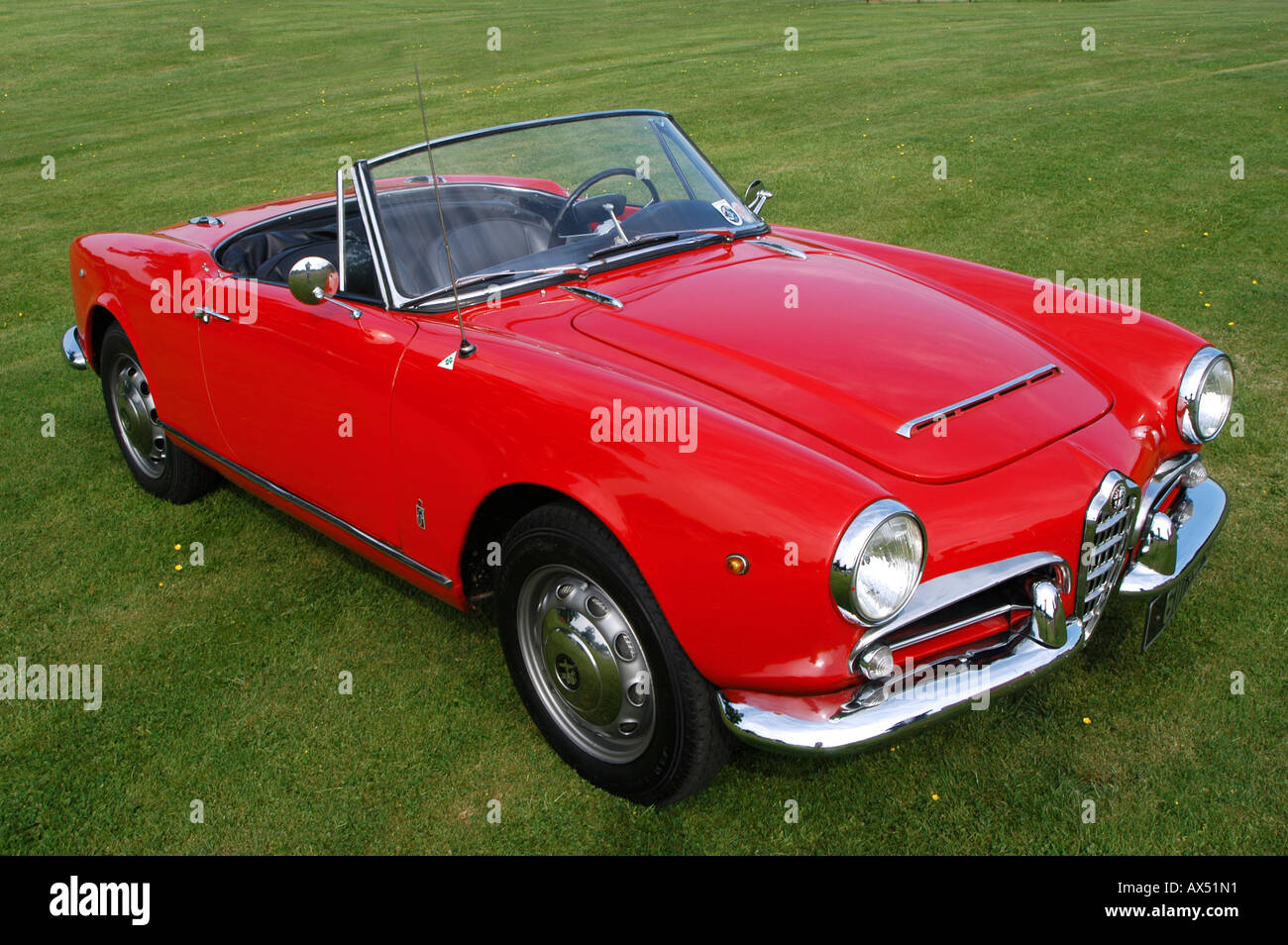 front detail of a red alfa romeo giulia 1964 1600cc classic sports stock photo royalty free. Black Bedroom Furniture Sets. Home Design Ideas