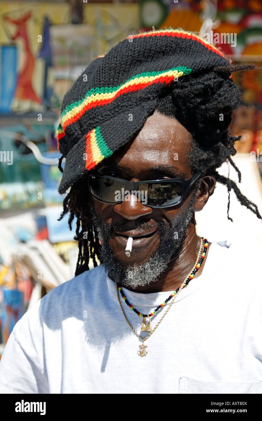 Jamaica Negril beach Rastafarian man Stock Photo