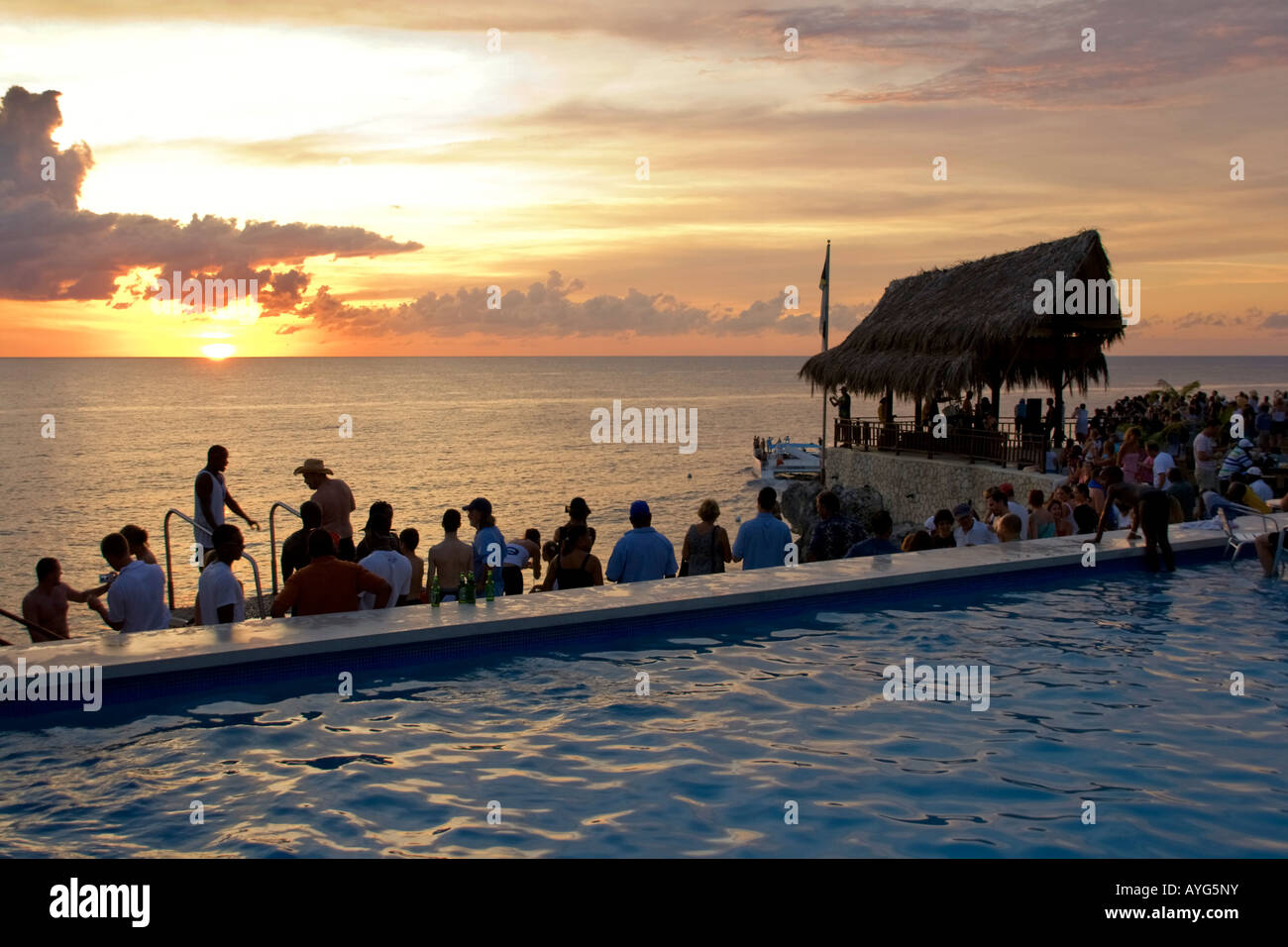 Jamaica Negril Rick s Cafe open air bar viewpoint at sunset Stock Photo