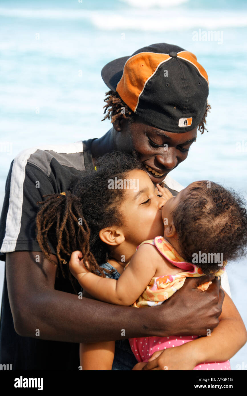 Jamaica Boston bay Jamaican father with kids kissing each other Stock Photo