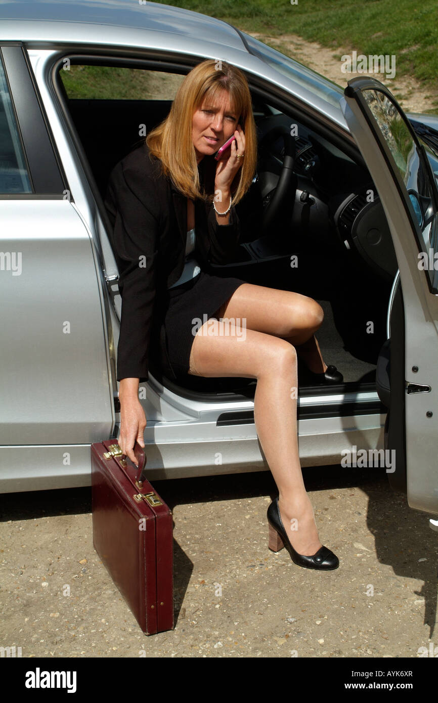 Unique Adult Woman In Mini Skirt Sitting On The Driver39s Seat