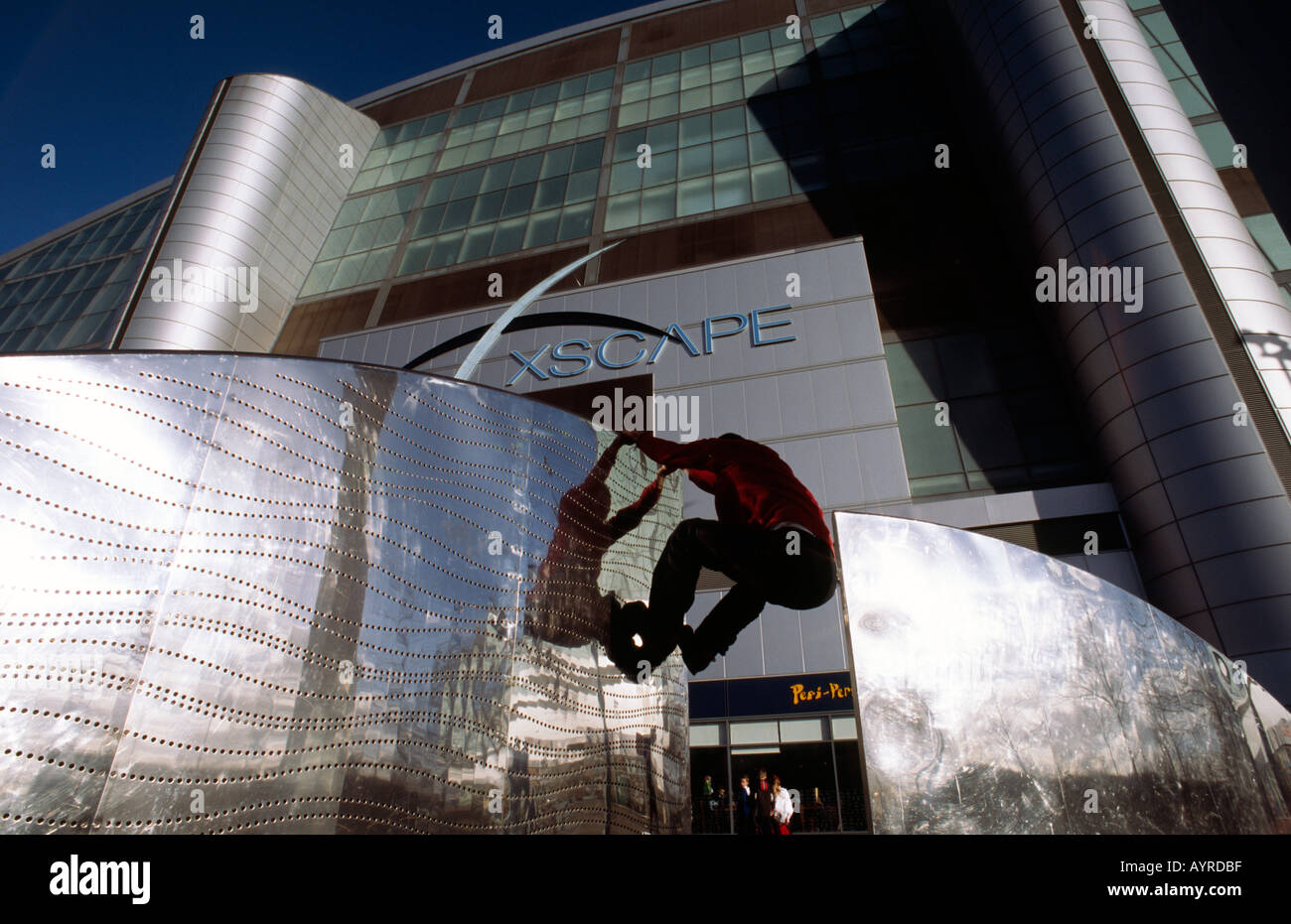 Doug Blane practicing Le Parkour climbing freerunning outside the Xscape snow dome Central Milton Keynes Stock Photo