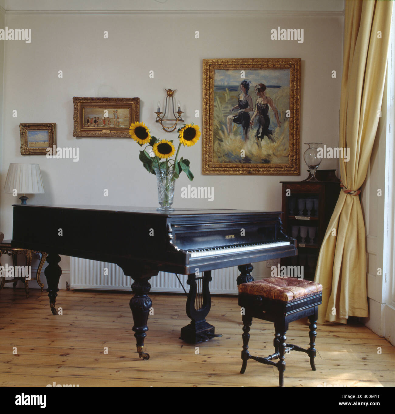 Grand piano and antique piano stool in living room with for Grand piano in living room