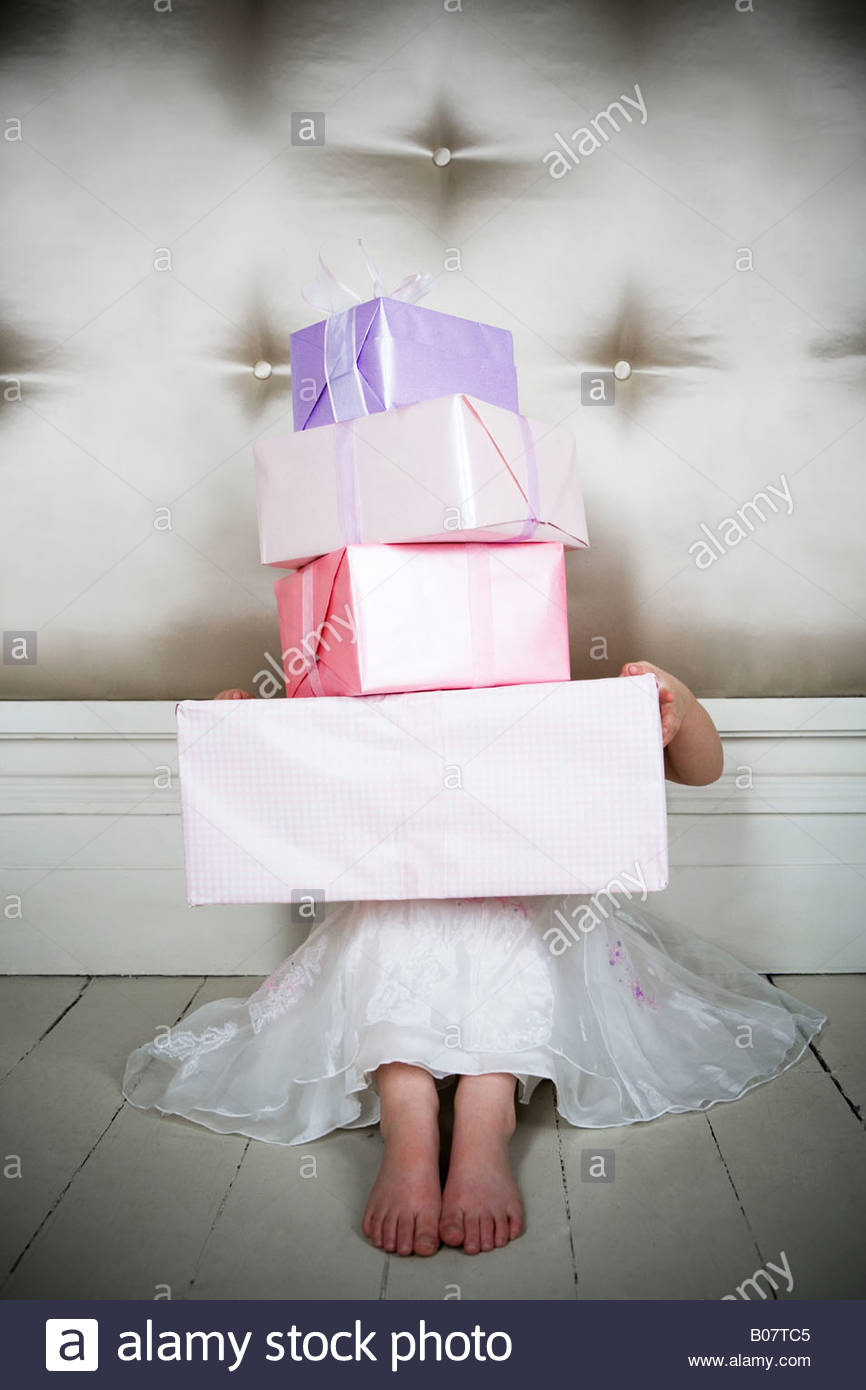Little girl with birthday presents Stock Foto