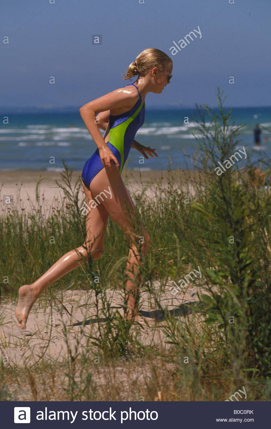 lively-young-teenage-girl-running-on-bea