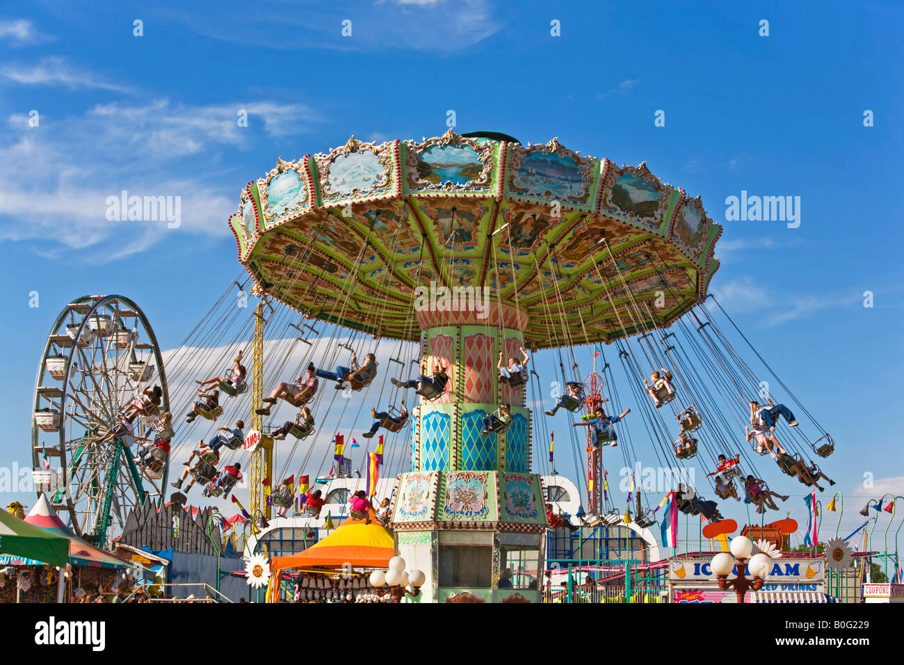 Carnival Swing Ride With Kids And Families Having Fun