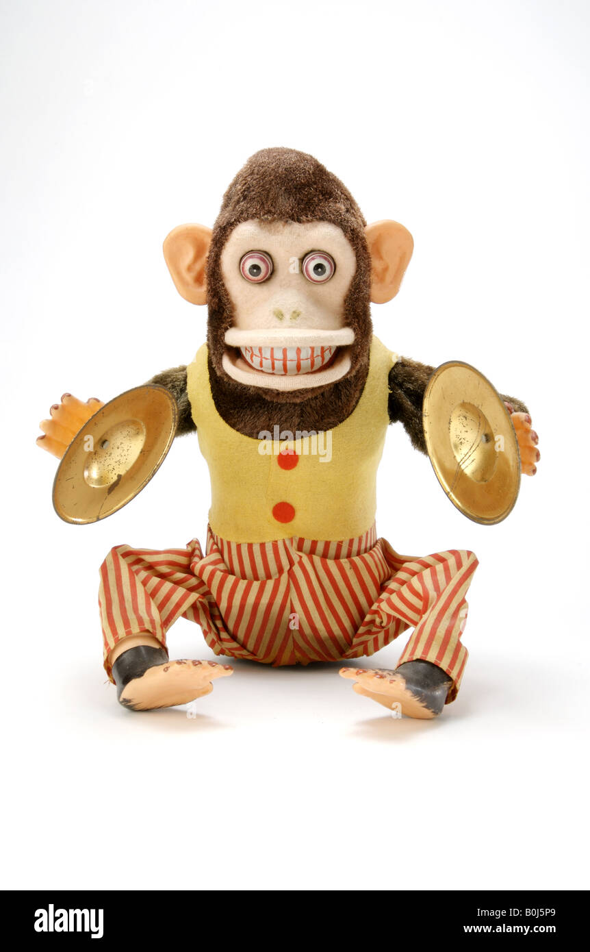 An antique childrens toy monkey that make noise Stock Foto