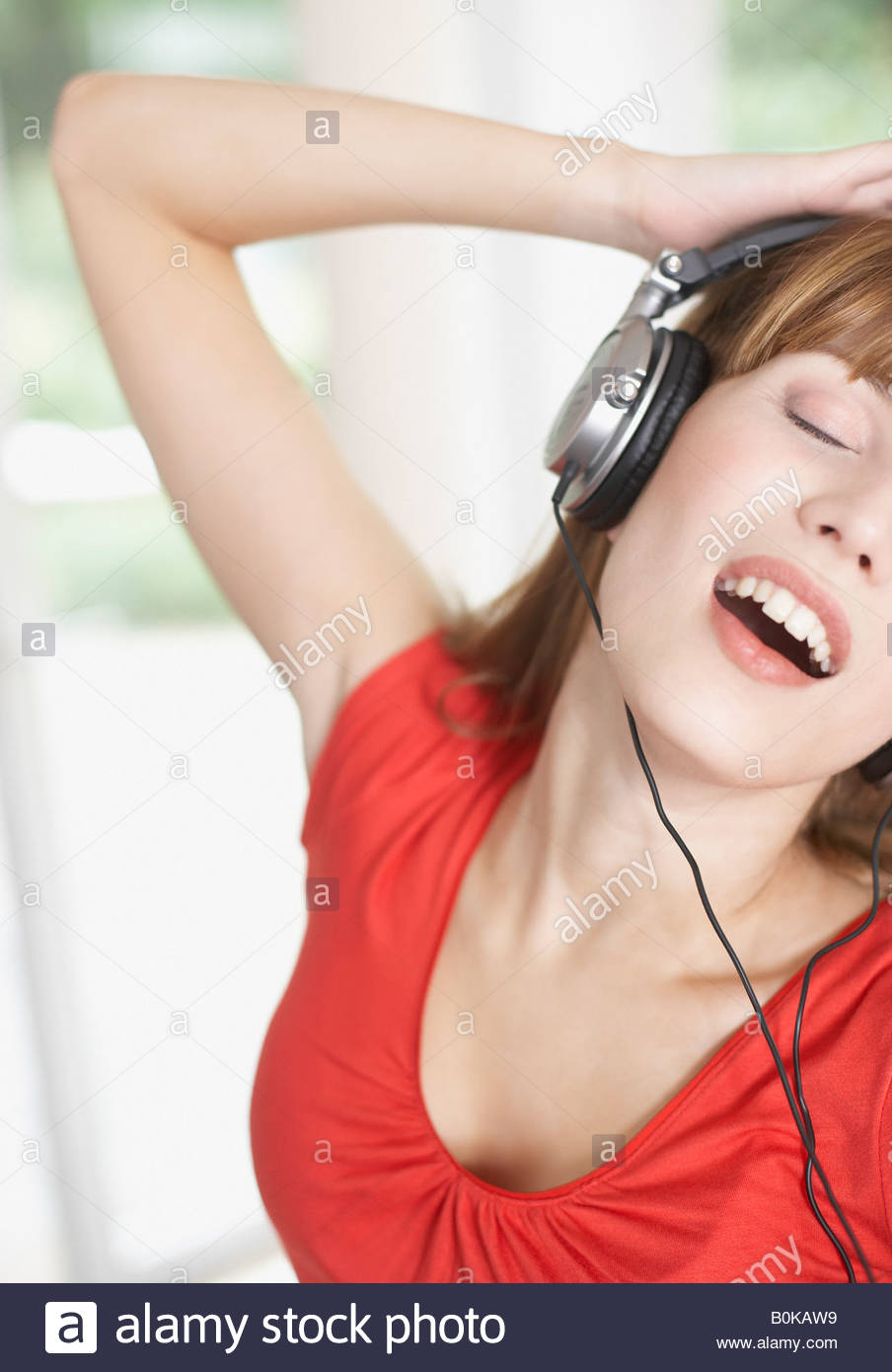Woman wearing headphones and dancing Stock Foto