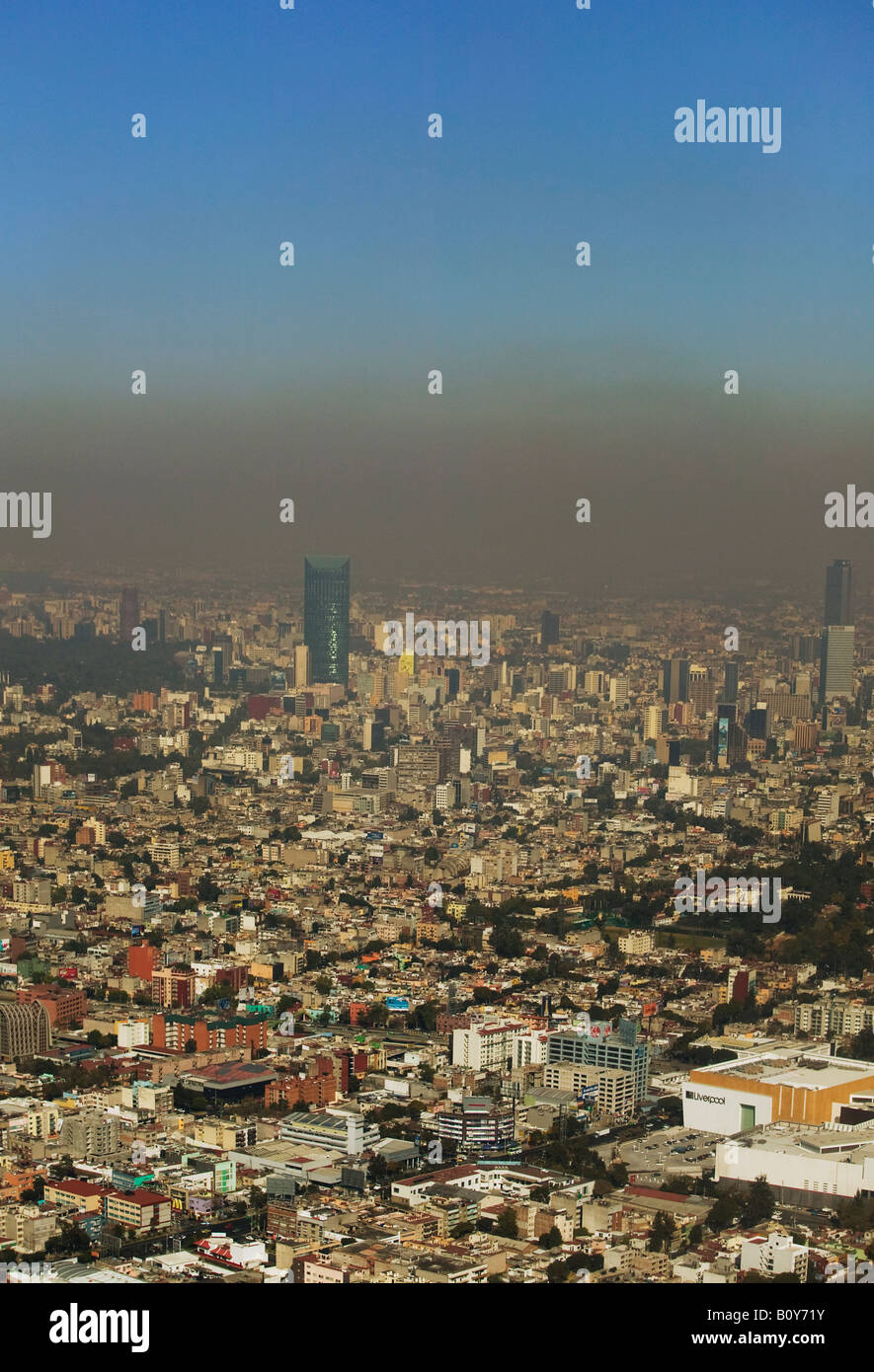 aerial above a layer of air pollution smog hanging over Mexico City Stock Photo