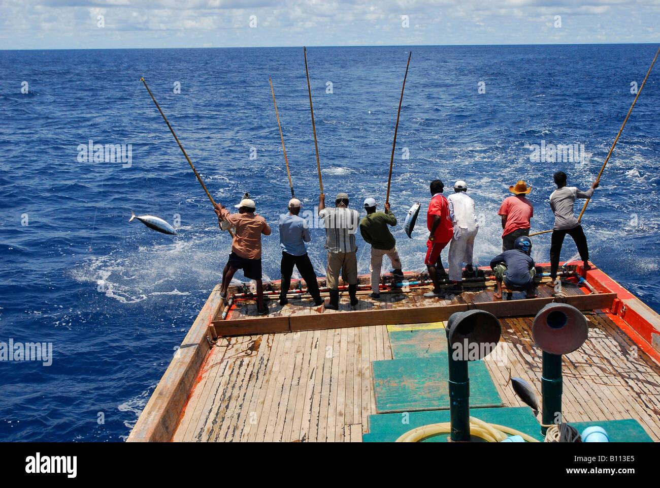 Tuna fishermen with traditional fishing rod indian ocean for Tuna fishing pole