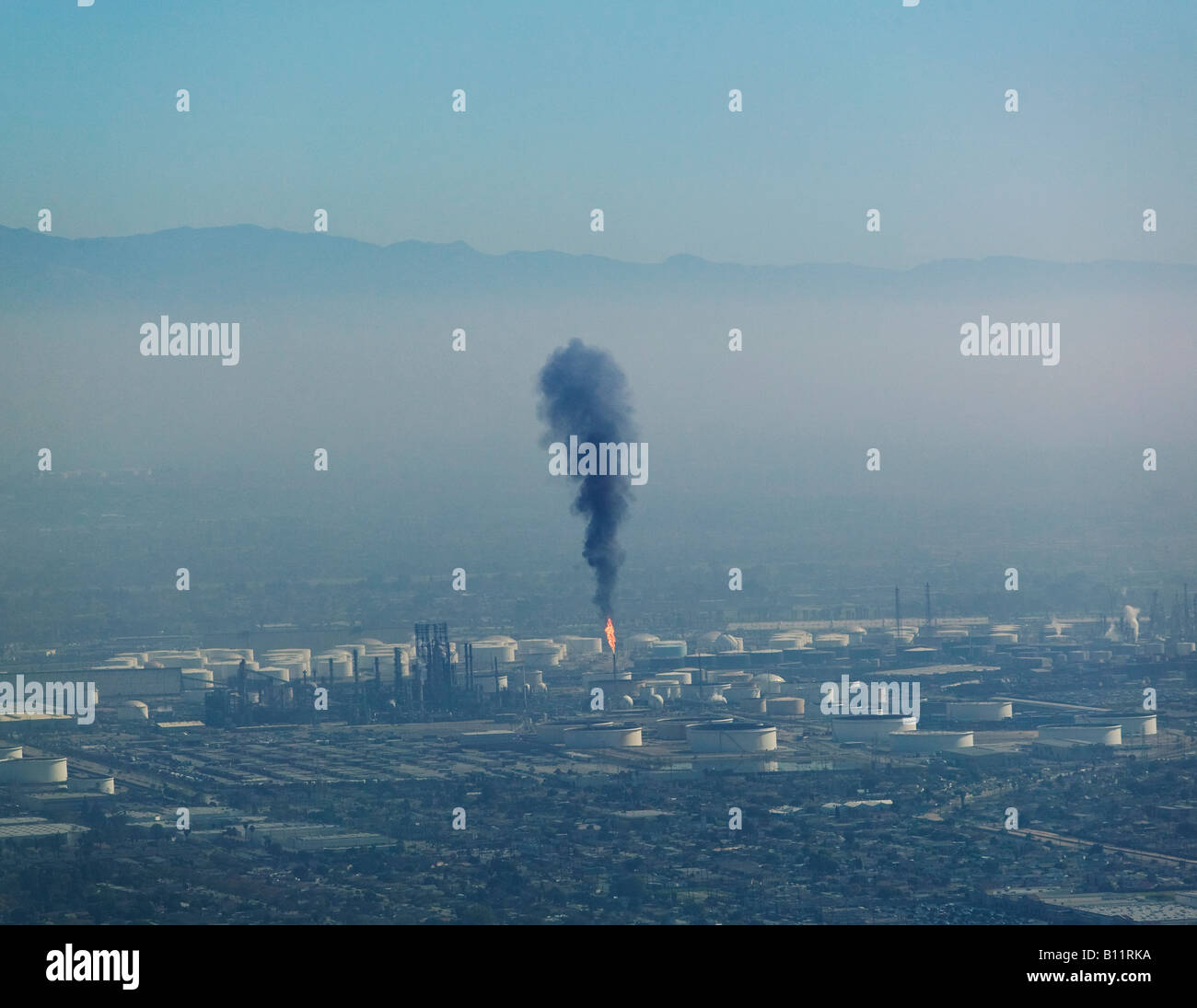 A layer of air pollution hangs over Los Angeles as a Long Beach refinery releases particulates Stock Photo