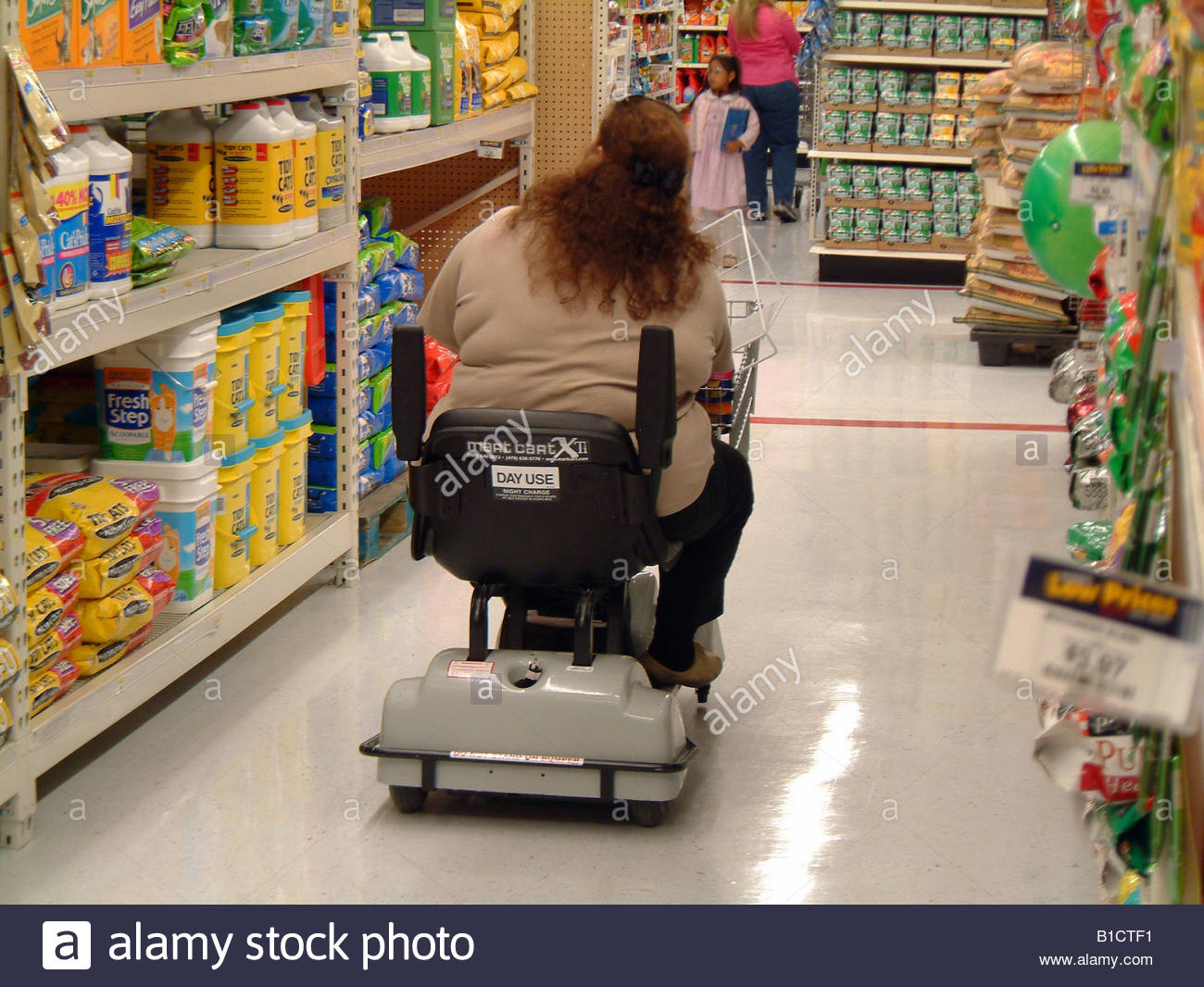 Fat obese woman on an electric shopping cart Wal Mart USA ...
