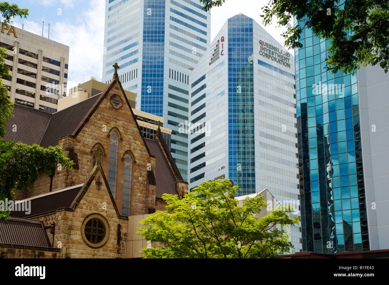 Office Building Tower Over An Old Church In The Centre Of Brisbane Stock Photo Royalty Free