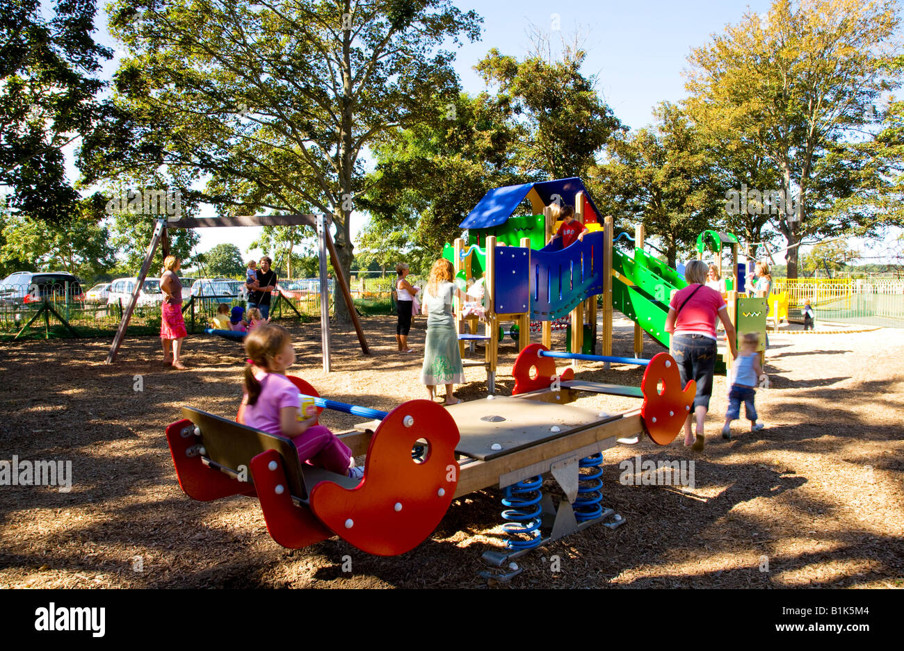Children playing on a modern adventure playground with ...