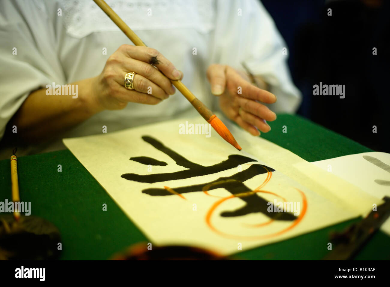 Japanese calligraphy master demonstrates her art Stock Photo