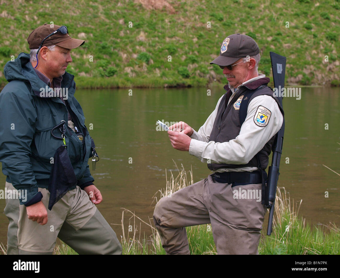 Us federal fish and wildlife officer checks fisherman 39 s for Fish and wildlife permit