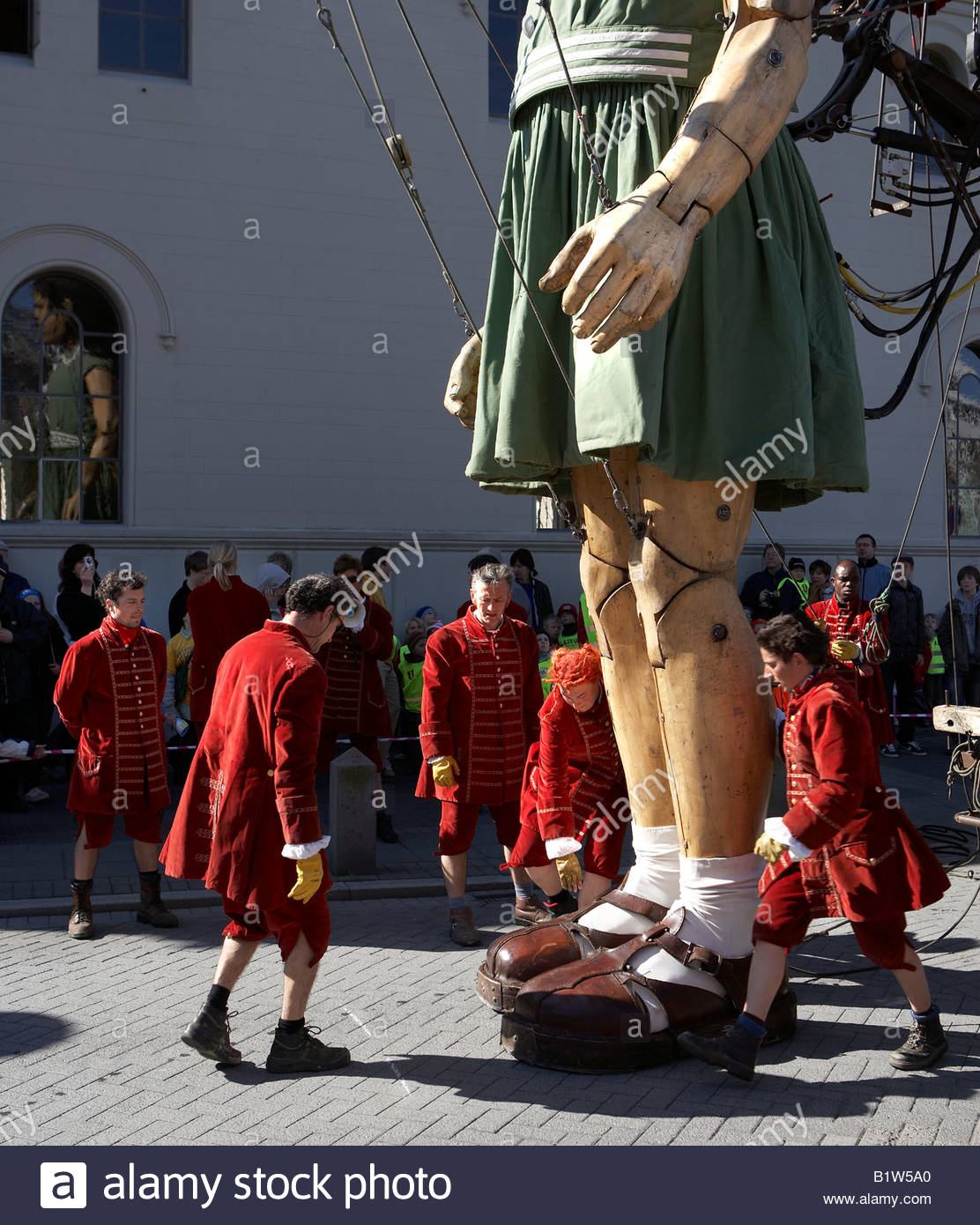 giant marionette puppet girl street performance by royal de luxe stock photo royalty free. Black Bedroom Furniture Sets. Home Design Ideas