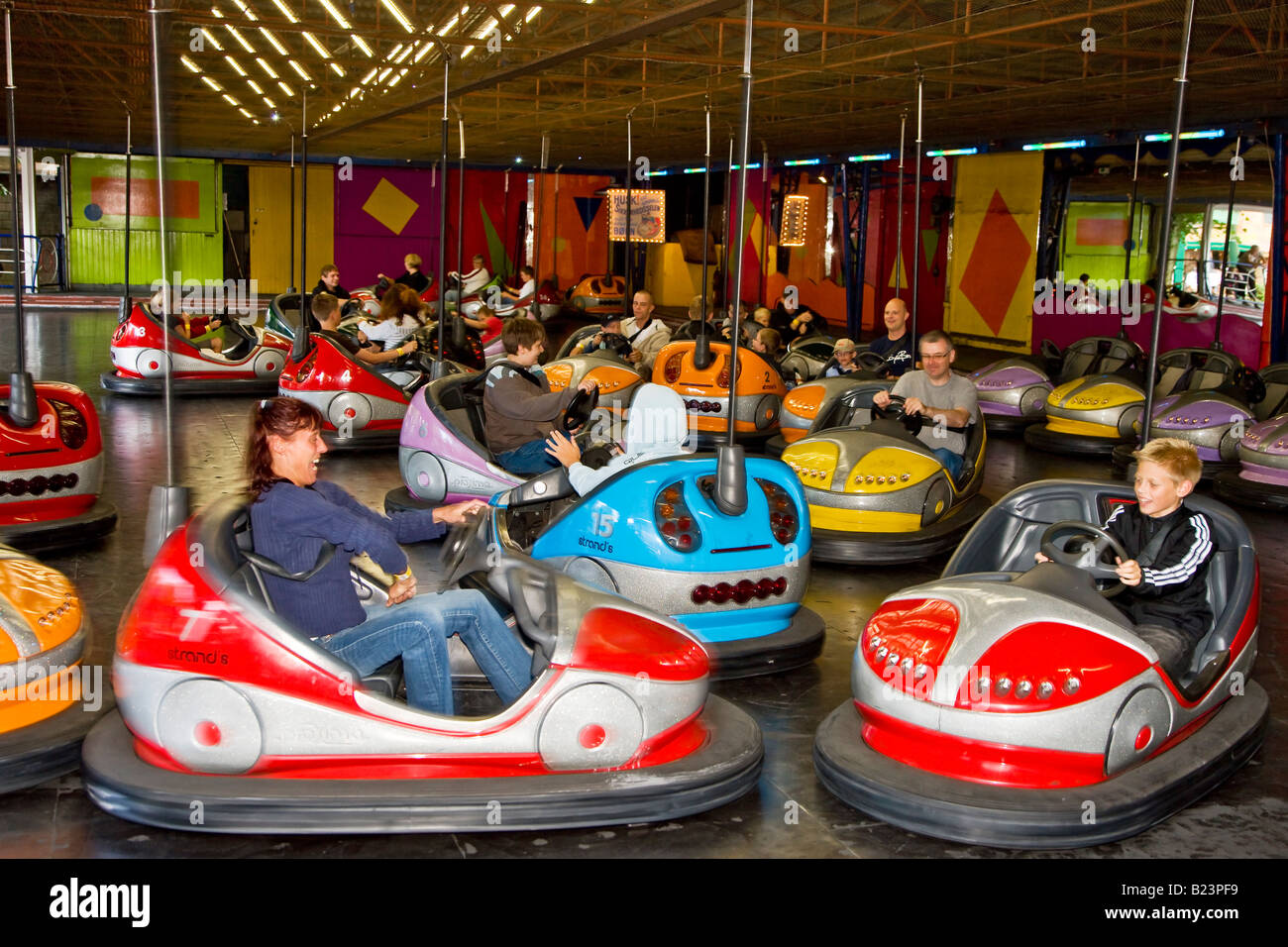 driving bumper cars in bakken amusement park stock photo