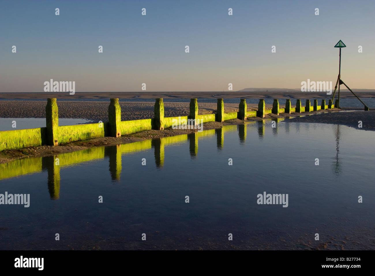 evening-sun-shining-on-breakwater-west-wittering-west-sussex-uk-B27734.jpg
