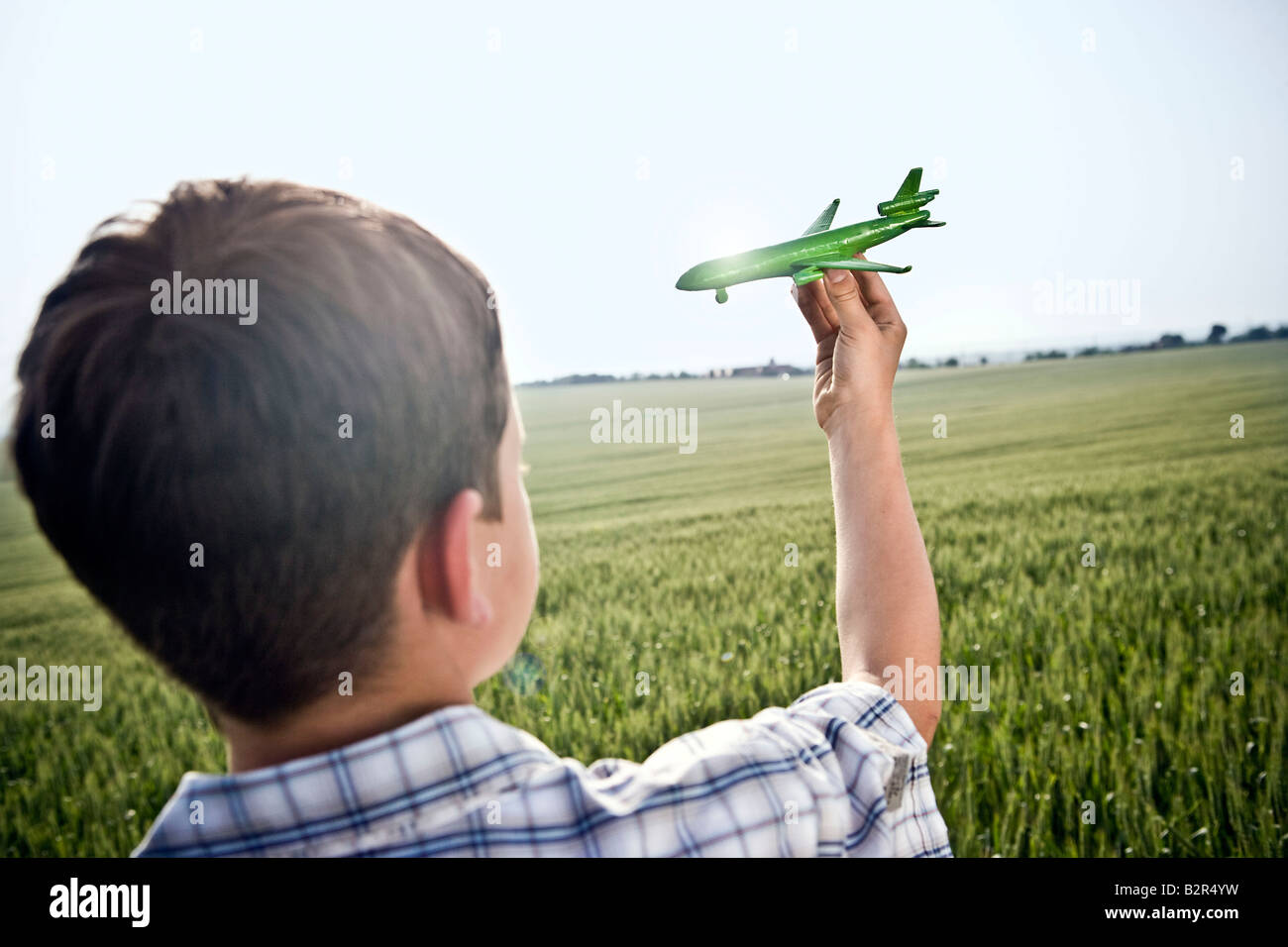 Boy playing with toy plane Stock Foto