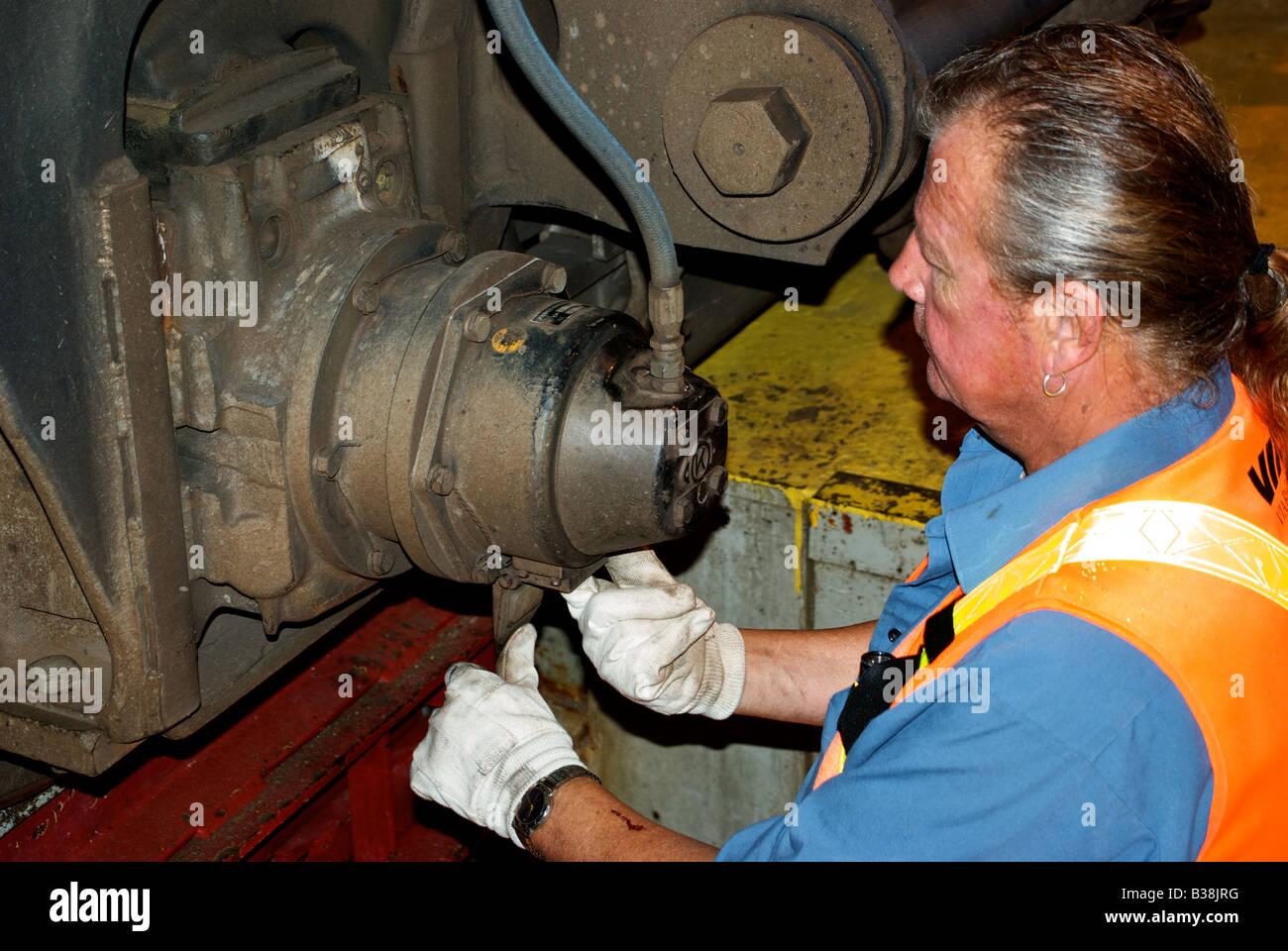 Heavy Duty Mechanic Working On Wheel Assembly Of Passenger Rail ...