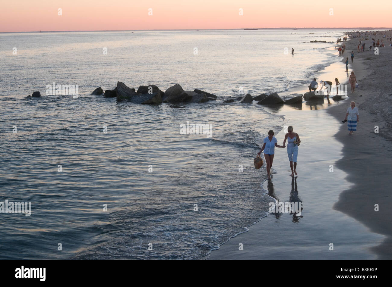 people-on-coney-island-beach-at-dusk-on-