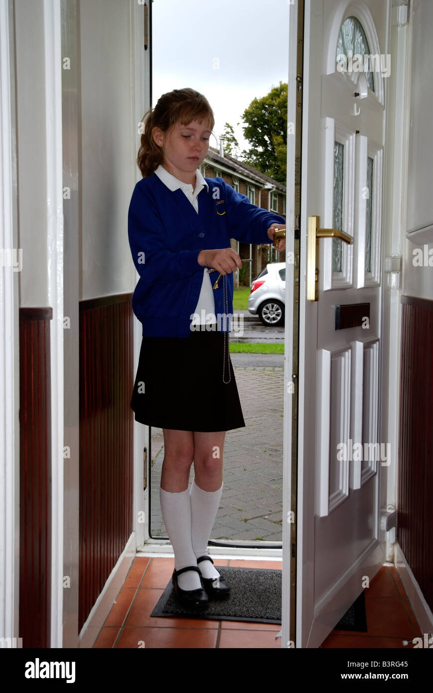 Latchkey Child A Young Schoolgirl Holding A Front Door Key