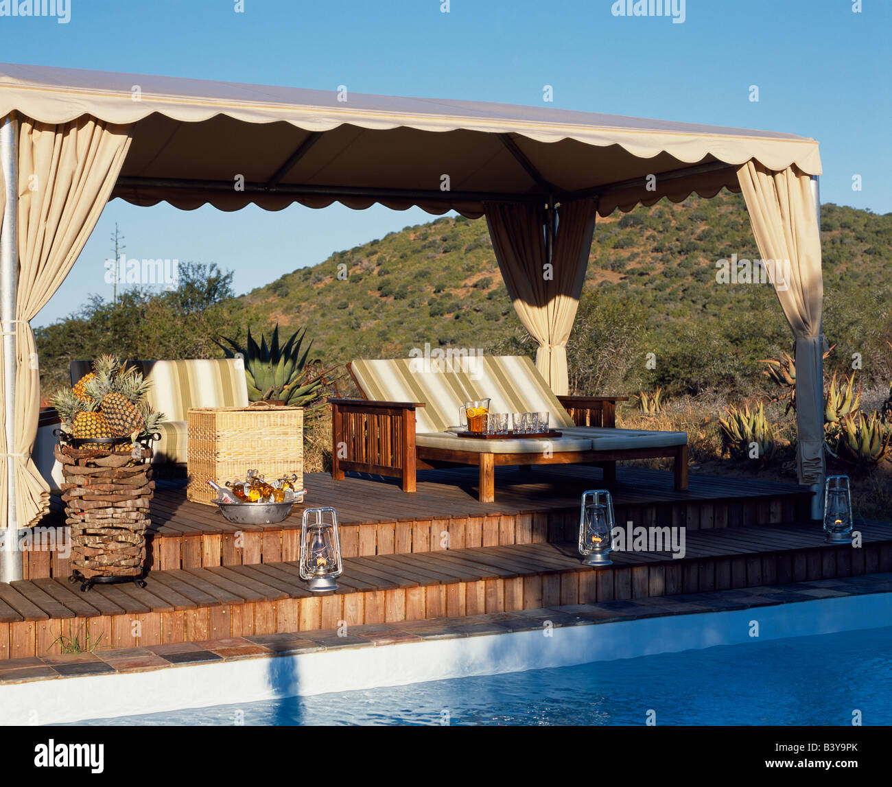 South Africa Eastern Cape Kwandwe Sun Loungers On A Canopied Deck Stock Photo Royalty Free