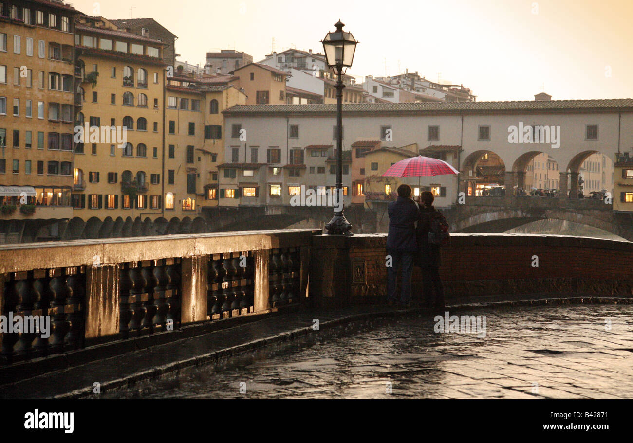 a-couple-looking-at-the-ponte-vecchio-in